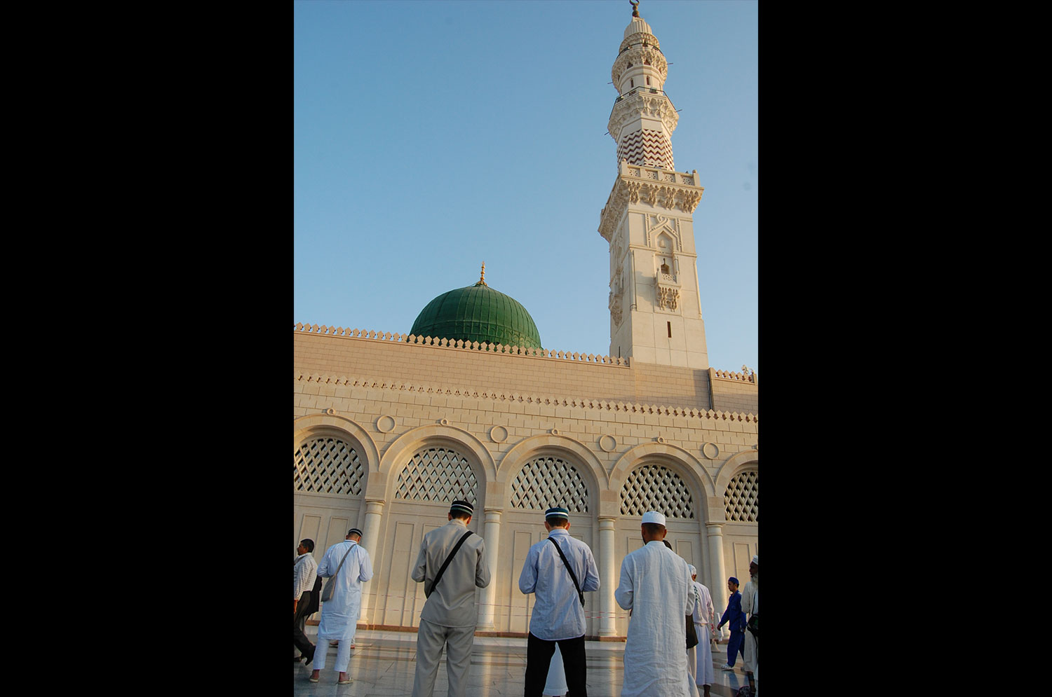 Flouting Wahabi doctrine, pilgrims pray to the Prophet Muhammad's grave.