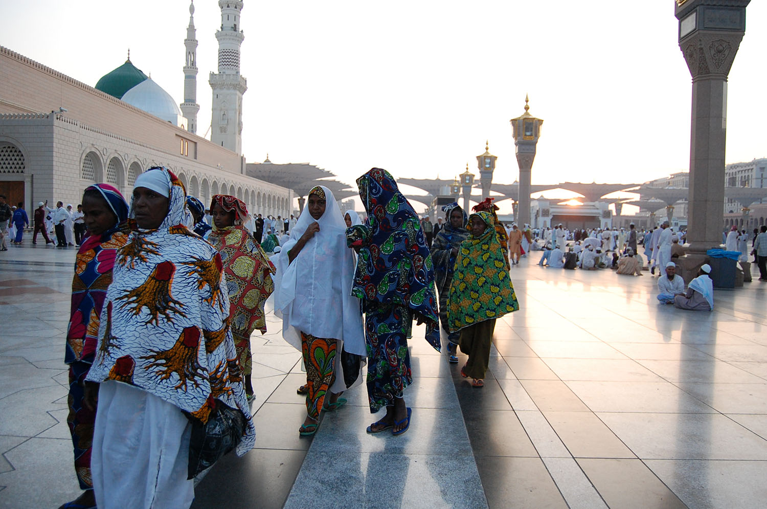 Colorfully dressed African women on the pilgrimage with the Prophet's grave in the background