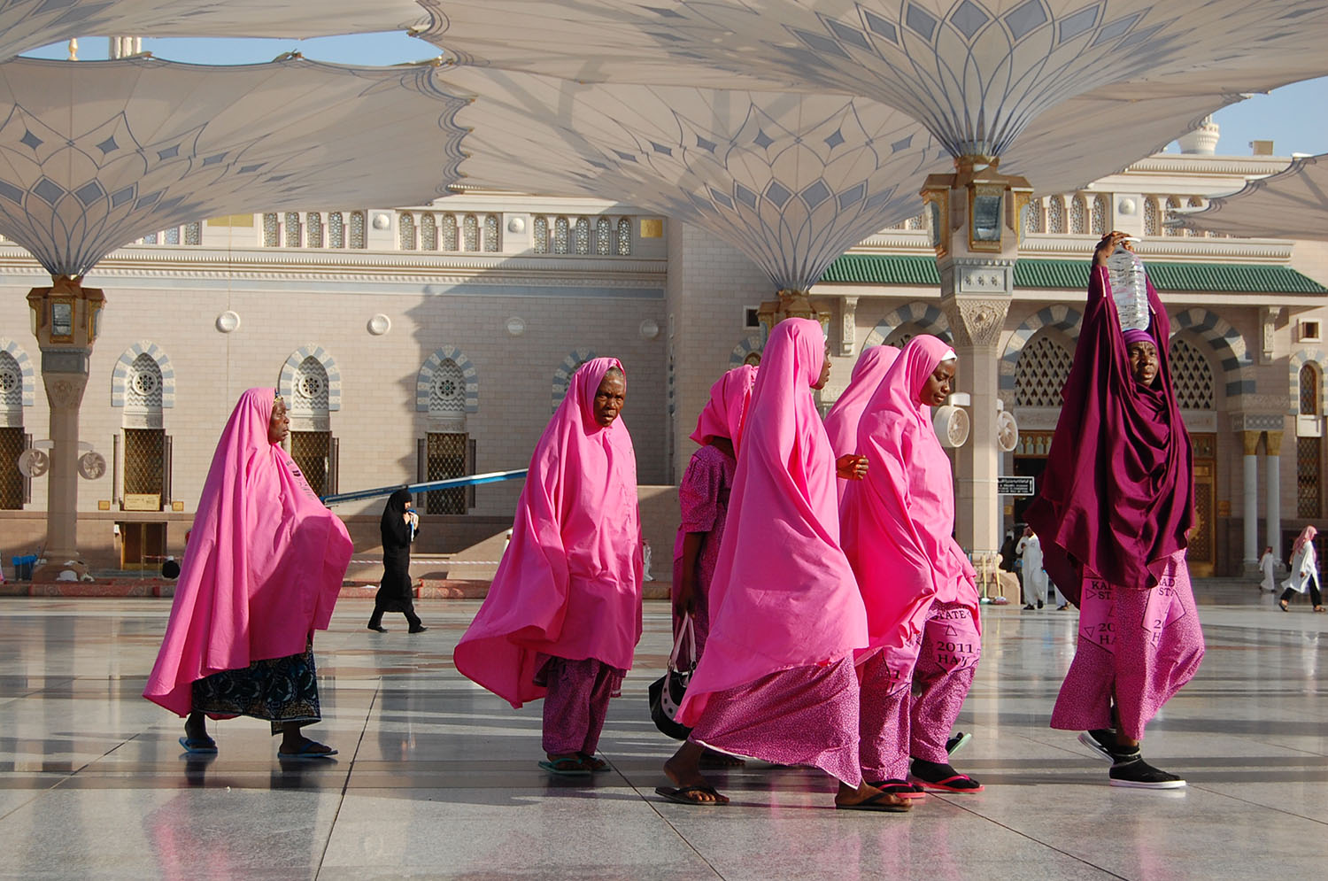 Like many, these African women pilgrims adopt a unique color code so they can find each other amongst millions.