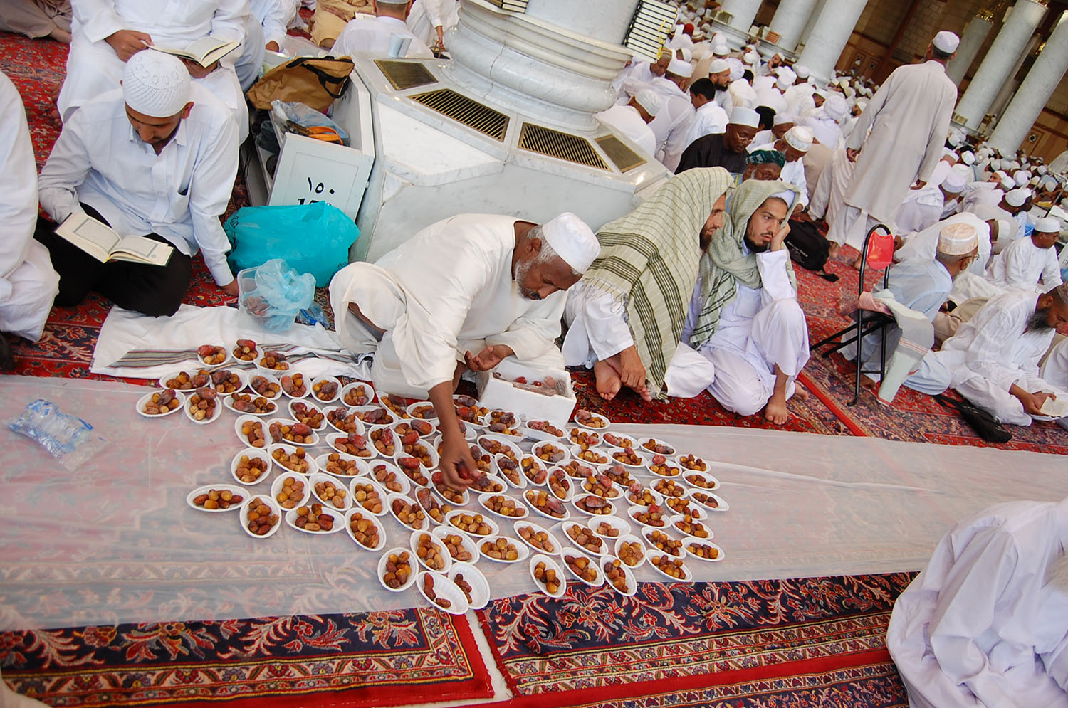A feast of dates is laid out inside the mosque.
